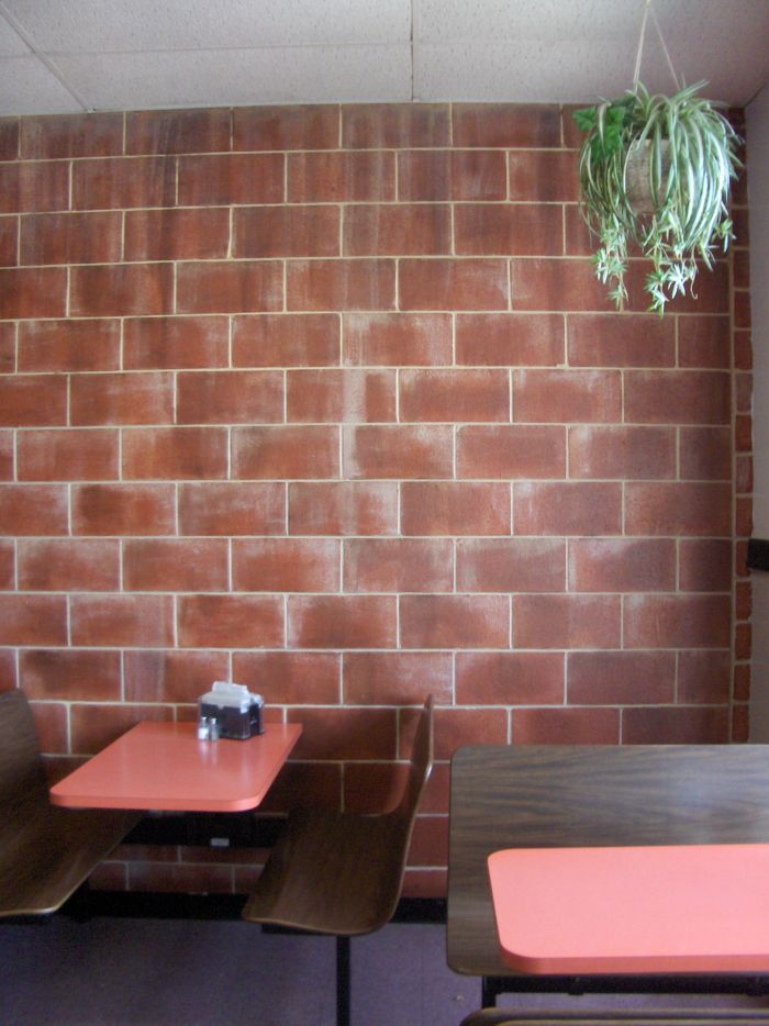 Faux Log Walls http://howtobuildahouseblog.com/painting-a-faux-brick-wall/