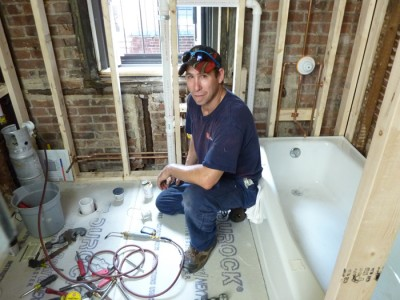 Plumber Plumbing a Bathroom