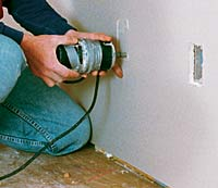 drywall router. in this case, you need to do that manually, using a jab saw or drywall router. with patience and exercise, router u