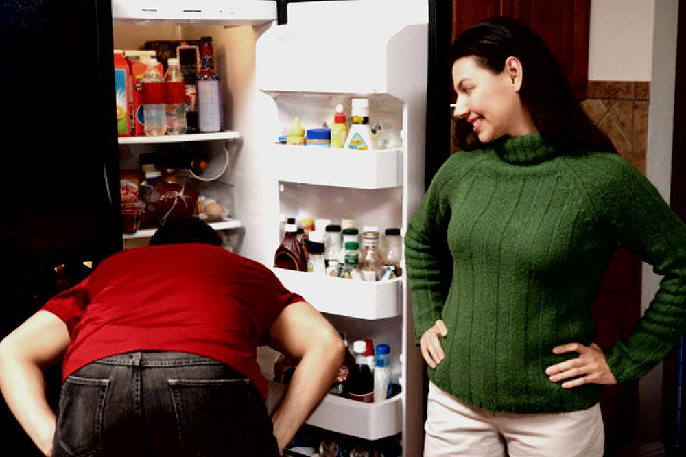 Couple Looking in Refrigerator